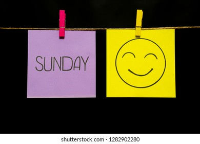 Copy space. Two multicolored stickers. On left a sheet inscription sunday. On the right sheet face with smile and good nature. Emotion.