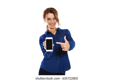 Copy space to your smart phone. Confident young woman showing on her smart phone and smiling while standing on a white background