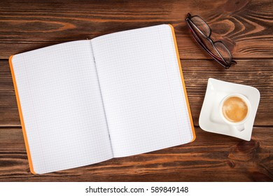 Copybook on a wooden table