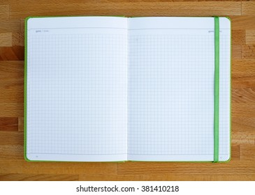 copybook on wooden table for business or education