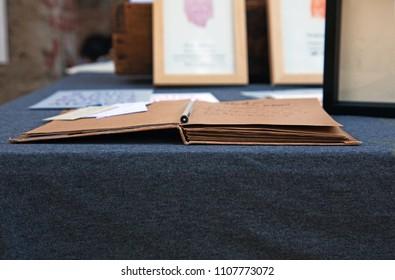 Copybook, pen on desk