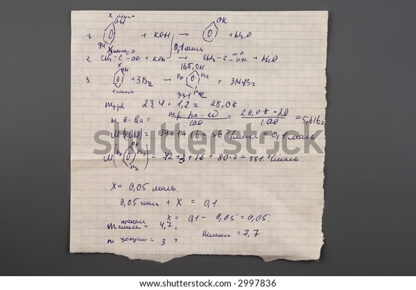 Copy-book sheet of paper with formulas isolated over gray