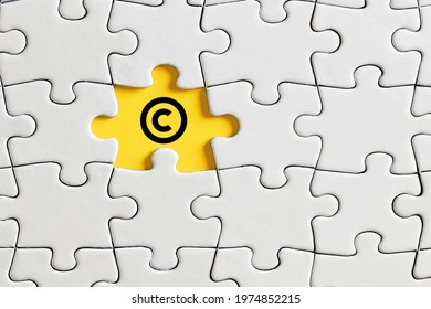 Copyright icon on missing puzzle piece. Property and intellectual rights protection.