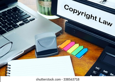Copyright Law - Office Folder on Office Desktop with Office Supplies. Business Concept on Toned and Blurred Background