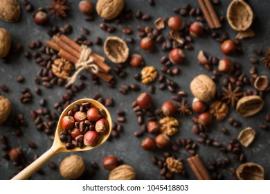 Copyspace background composition with the borders made of multiple different nuts. Cooking Ingredients dark background. Natural organic healthy food concept. Top view