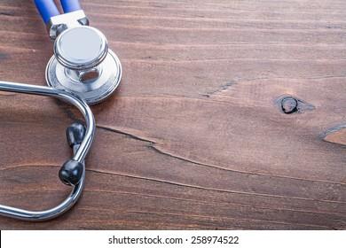 copyspace close up medical stethoscope on vintage wooden board medical comcept