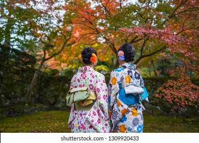Copyspace of Japanese wearing kimono with autumn leaves on background