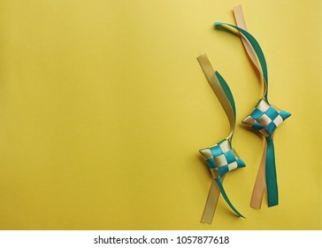 """Copyspace of Malaysian food decoration called """"Ketupat"""" on yellow background"""