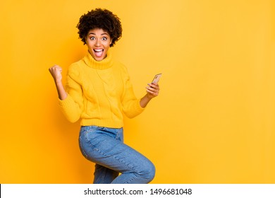Copyspace photo of brown excited ecstatic cheerful cute charming nice girlfriend black blogger wearing jeans denim jumper overjoyed with someone starting following her isolated with bright background