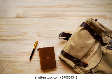 Copyspace : Top view of pen, notebook and bag as travel concept