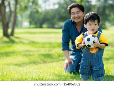 Copy-spaced image of a cute baby boy with a ball in hands