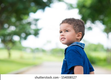 Copy-spaced image of a cute little boy in the park