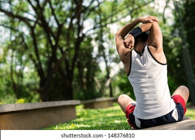 Copy-spaced image of a sporty person doing back stretching outside