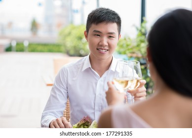 Copy-spaced image of a young man having lunch at a restaurant with his girlfriend on the foreground
