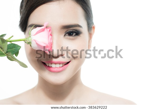 Copy-spaced portrait of a beautiful lady with a rose flower over a white background. Woman day concept. Closeup fresh face girl.