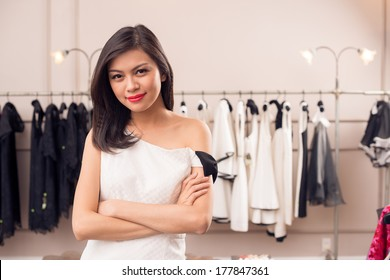 Copy-spaced portrait of a young fashion model in a boutique on the foreground