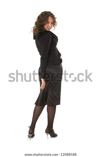 coquette woman in black looking back