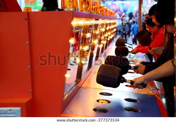 Coquitlam, BC, Canada - April 09, 2015 : People playing whack game at carnival