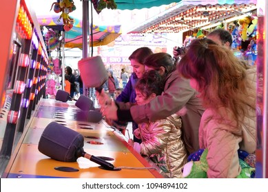 Coquitlam, BC, Canada - April 15, 2018 : Motion of people playing whack game at the West Coast Amusements Carnival
