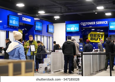 Coquitlam, BC, Canada - December 30, 2016 : People line up for buying gift at check out counter inside Best buy store