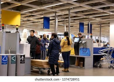 Coquitlam, BC, Canada - February 01, 2019 : Motion of people paying product at self check out counter inside Ikea store in Coquitlam BC Canada