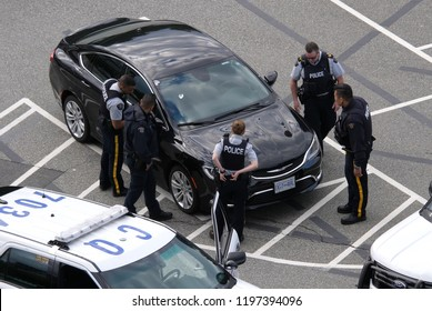 Coquitlam, BC, Canada - July 07, 2018 : Motion of police catching a stolen car at parking lot in Coquitlam BC Canada