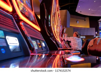 Coquitlam, BC, Canada - June 12, 2018 : Motion of people playing slot machine inside Casino