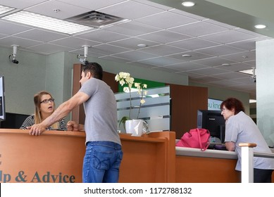 Coquitlam, BC, Canada - May 14, 2018 : Motion of people talking to the teller at service counter inside TD bank
