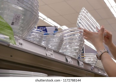 Coquitlam, BC, Canada - May 14, 2018 : Motion of woman hand picking glass bowl inside London drugs store