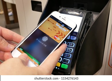 Coquitlam, BC, Canada - May 24, 2018 : Motion of man using apple pay to pay foods at Mcdonalds restaurant