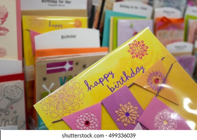 Coquitlam, BC, Canada - October 14, 2016 : Close up woman holding happy birthday card inside superstore