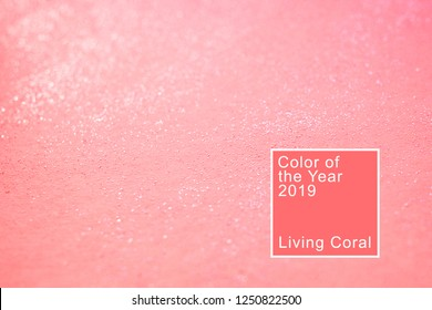 Coral background with glitter. Living coral. Color of the  2019.