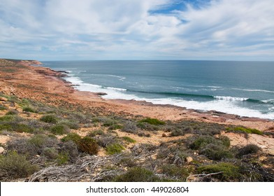 The coral coast with turquoise Indian Ocean waters, sandstone and native flora at Red Bluff in Kalbarri,Western Australia/Peaceful Coral Coast Seascape/Red Bluff,Kalbarri, Western Australia