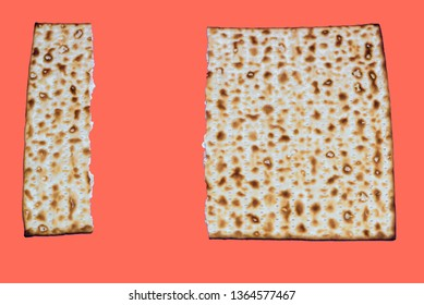 Coral color of the Year 2019. Matzah on trendy color background. Matza Jewish traditional Passover unleavened bread. Pesach celebration symbol.