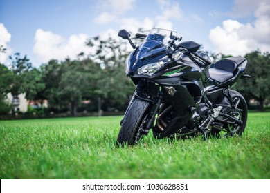 Coral Gables, Florida / October 17, 2017: 2017- Kawasaki Ninja 650 ABS Sport Bike / Motor Bike, Metallic Black on a grass pasture.