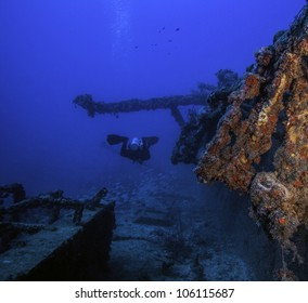 Coral growth on the USCG Bibb in Key Largo, Florida. an artificial reef in the John Pennekamp State Park. With a technical diver swimming alongside the wreck