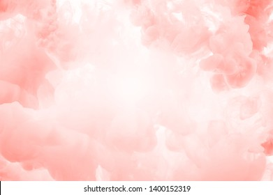 Coral ink splashes abstrct background. Studio shot with seamless watercolor swirls in the water