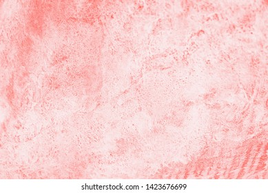 Coral pink color background. Concrete or beton pattern. Copy space