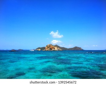 coral in the sea with blue sky clound and moutain.coral in the sea with blue sky clound.