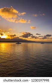 Coral sea Port Douglas sunburst reflections Daintree background calm cloudy coastal afternoon tropical summer evening
