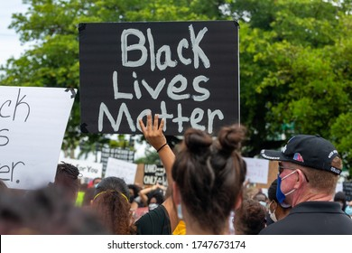Coral Springs, Florida/USA - June 02, 2020: Peaceful protesters in a protest against the death in Minneapolis police custody of African-American man George Floyd at Coral Springs, Florida.