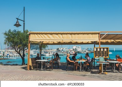 Coralejo, Fuerteventura Island, Spain - April 03, 2017: Street view of Corralejo with bars and restaurants in the port