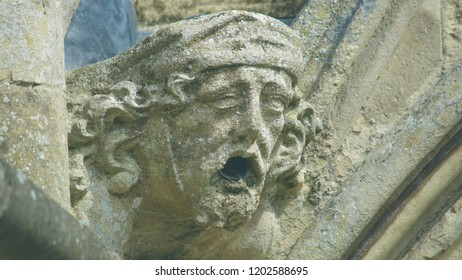 Corbel Head on The West Front of Salisbury Cathedral B, Gargoyle on Early English Gothic Cathedral, shallow depth of field split toning horizontal photography