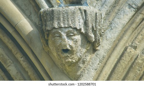 Corbel Head on The West Front of Salisbury Cathedral J, Gargoyle on Early English Gothic Cathedral, shallow depth of field split toning horizontal photography
