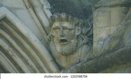 Corbel Head on The West Front of Salisbury Cathedral D, Gargoyle on Early English Gothic Cathedral, shallow depth of field split toning horizontal photography