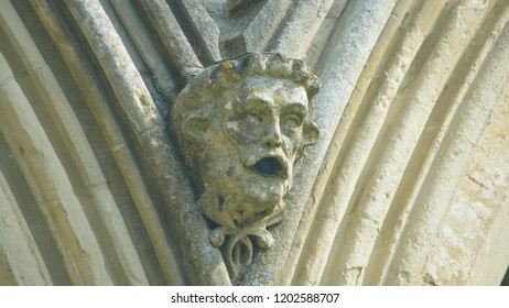 Corbel Head on The West Front of Salisbury Cathedral E, Gargoyle on Early English Gothic Cathedral, shallow depth of field split toning horizontal photography