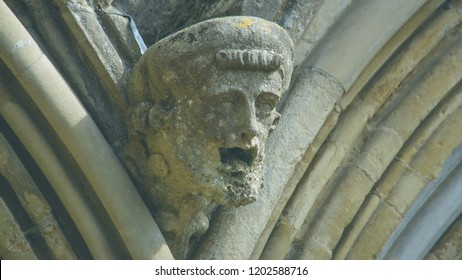 Corbel Head on The West Front of Salisbury Cathedral A, Gargoyle on Early English Gothic Cathedral, shallow depth of field split toning horizontal photography
