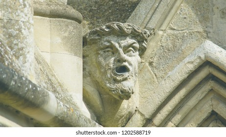Corbel Head on The West Front of Salisbury Cathedral I, Gargoyle on Early English Gothic Cathedral, shallow depth of field split toning horizontal photography