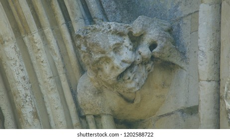 Corbel Head on The West Front of Salisbury Cathedral H, Gargoyle on Early English Gothic Cathedral, shallow depth of field split toning horizontal photography