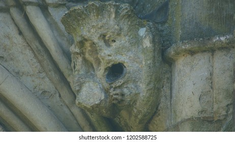 Corbel Head on The West Front of Salisbury Cathedral L, Gargoyle on Early English Gothic Cathedral, shallow depth of field split toning horizontal photography